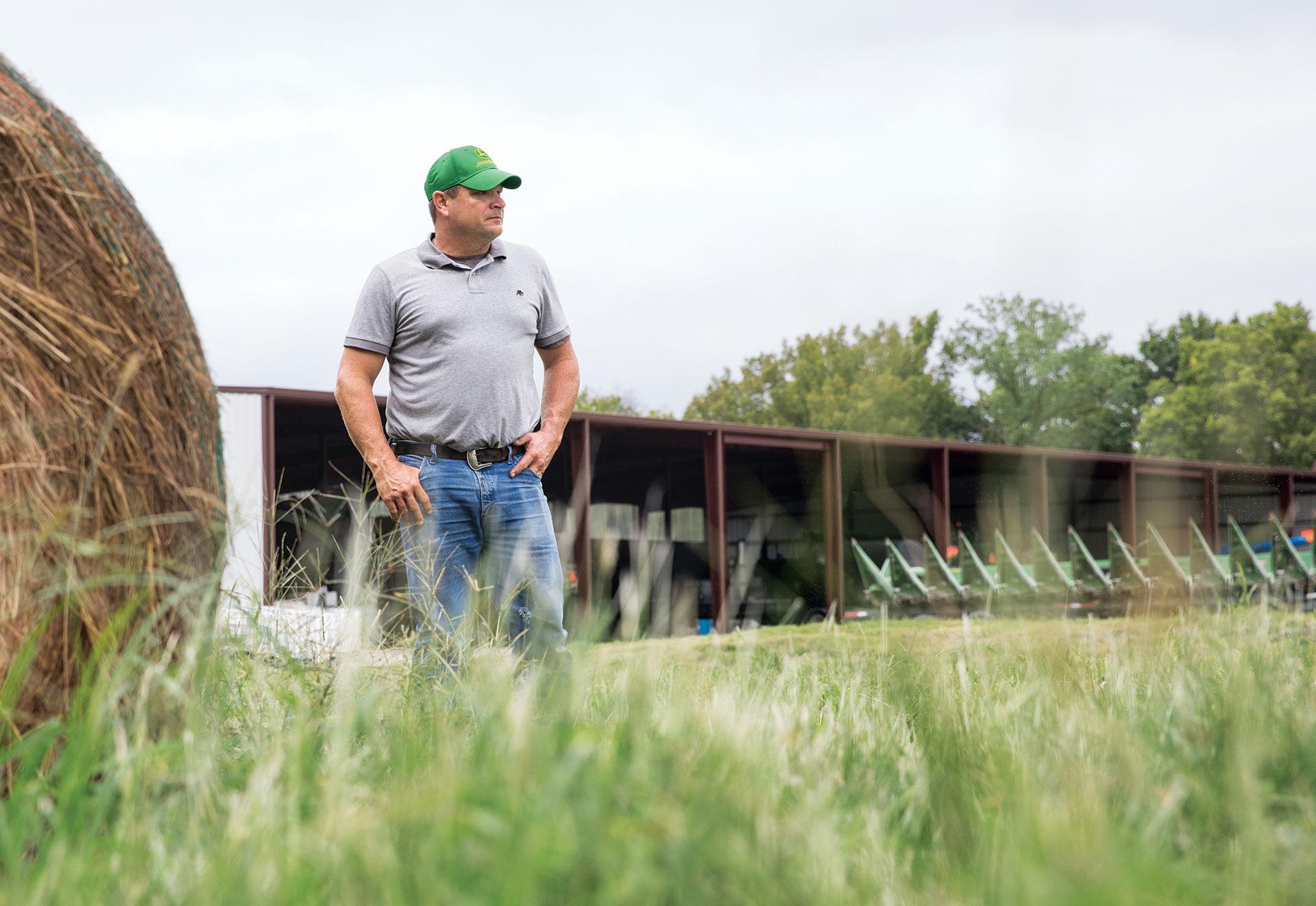 Farmer on the field with a John Deere hat