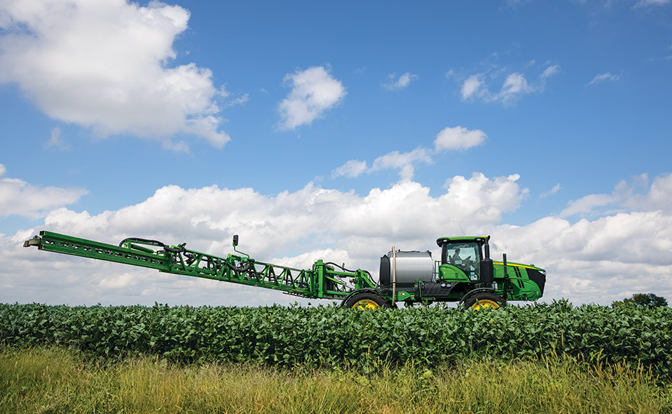 John Deere combine in field